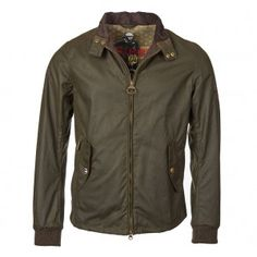 This Steve McQueen windcheater from Barbour international features an earthy olive colour ideal for this seasons elemental trend. Designed to ground your style no matter what the weather is, this waxed piece from Barbour is a must have which you will retu