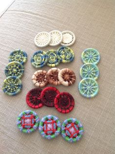 Thread buttons. Mostly Dorset buttons or variations of Dorset buttons.
