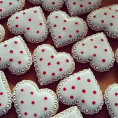 Valentine's Day decorated heart sugar cookies. Royal icing. White, red. Polka dots.
