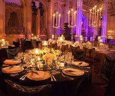 Large candelabras add a dramatic effect to this stunning reception space.