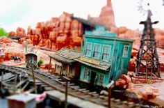 Tilt-Shift: This picture of Disney World's Gold Dust Saloon from Big Thunder Mountain by William Mandra works for the same reason: the buildings are so unique and just-so-slightly cartoonish that your mind is more willing to accept that they are models than actual full-scale buildings.