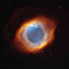 """This image of the coil-shaped Helix Nebula (also known as """"The Eye of God"""") is a composite of images from the Hubble Space Telescope and from the Mosaic Camera on the National Science Foundation's 0.9-meter telescope at Kitt Peak National Observatory near Tucson, Ariz."""