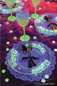 We applied dimensional glow-in-the-dark paint underneath these clear plate chargers for a ghoulish look. See more spooky ideas here!