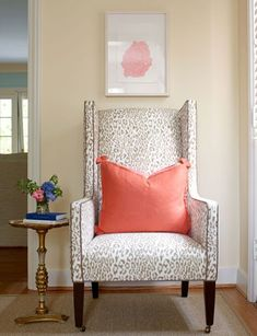 Fantastic vignette. Cheeky animal print chair, abstract art, petite side table, coral pillow.