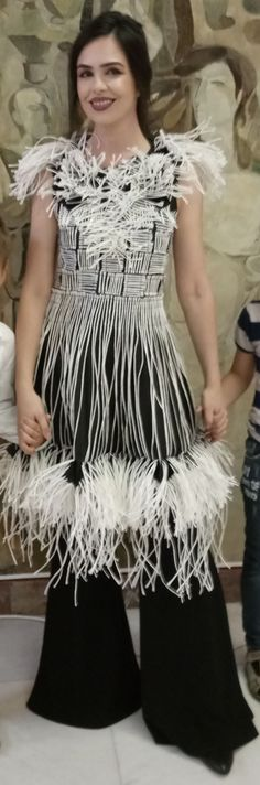 Unique dress made of conventional and unconventional materials. More details at muzacreationfactory@yahoo.com.