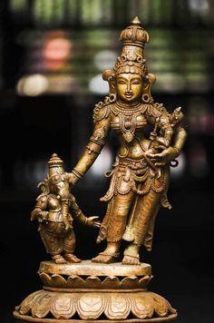Goddess Parvathi and her sons Lord Ganesha & Lord Subrahmanya. Saraswati Goddess, Shiva Shakti, Durga, Ancient Goddesses, Gods And Goddesses, Indian Gods, Indian Art, Jai Mata Ki, Indian Temple Architecture
