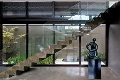Luxury Vila Madalena with Smooth Indoor Decor shining surfaces glass black metal framing