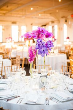 Pink and purple orchids: http://www.stylemepretty.com/new-york-weddings/new-york-city/manhattan/2015/03/18/colorful-tribeca-rooftop-wedding/ | Photography: W Studios - http://www.wstudiosnewyork.com/