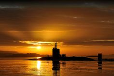 Trafalgar-class attack submarine HMS Triumph, glides into HM Naval Base Clyde. Royal Navy Photo
