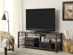 Tv Console by Coaster Furniture. Includes (1) Media Console with Decorative Ornamental Sides. Two Black Glass Shelves. Other accessories sold separately.