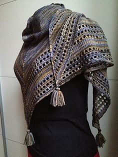 I like this shawl! It doesn't call for a ton of fingering-weight yarn, it uses size 8 needles, and the simple pattern and tassels make it fun and versatile.