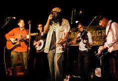 """Gangstagrass • www.gangstagrass.com • GangstagrassGoes Back to the Future WithRappalachiaAn Innovative Blend of Rap and BluegrassThe Band'sSnoop DoggMeetsBill MonroeSoundBreaks Barriers and Destroys Genres With Its EclecticMix of Low Down and Down Home Beats. The Gangstagrass Song """"Long Hard Times To Come""""Is The Theme of theFX Series JustifiedandReceived anEmmy Nominationfor OutstandingOriginal Main Title Theme Music"""