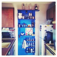 A pop of blue brings cheer to our 70's kitchen (and much needed storage)
