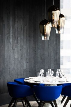 Tom Dixon has designed a restaurant in Hong Kong. Blue chairs.