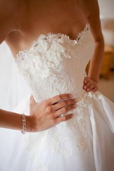 Strapless + sweetheart neckline + lace= beautiful wedding gown.