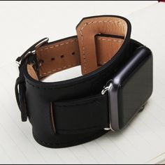 Black Apple Watch Band, 42mm or 38mm, leather cuff Black Apple Watch band, 42mm or 38mm leather cuff. Please select your size when you purchase.  I have others, please see my other listings or send me a message. It has Silver Hardware and black stitching.  Design is inspired by equestrian fixtures. Allows the heart rate sensor to remain in contact with the wrist.  3 separate pieces that connect to each other and to the iWatch.  Very easy to put together.  NOTE: Only the wristband is for…