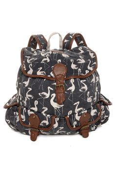 """You'll never run adrift from adorable when you're carrying the Billabong Drift Away Black Flamingo Print Backpack! Faded black canvas has an irresistible ivory flamingo print allover, with brown vegan leather trim along shoulder straps, belted top flap, and exterior pockets with belts or button closures. Drawstring top with zippered interior pocket. Brass hardware. Logo tag on top flap. Adjustable shoulder straps and top handle with 3"""" drop. Backpack measures 13"""" wide by 14&..."""