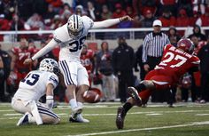 Rivalry moments: Utah's Brandon Burton blocks a field goal by BYU kicker Mitch Payne in 2010. The final score was Utah 17-BYU 16. (Trent Nelson     The Salt Lake Tribune)