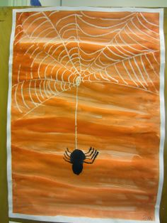 so cute just draw a web with white crayon then paint over it with water colors and add a spider