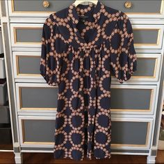 Patterned Banana Republic dress Lightweight, comfy dress with a fun pattern. I love it with black leggings, black boots, and gold jewelry! Banana Republic Dresses Midi