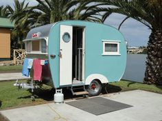 Vintage Caravan, made by Castle Caravans of Castle Hill, New South Wales, Australia. The glass port hole on the door is etched with a castle motif.