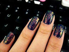 Sally Hansen Hidden Treasure (over a dark purple/blue nail polish)