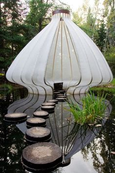 White seed pod water garden sculpture. Excel in the area of your interest.  http://youtu.be/bK7NUdh01WY