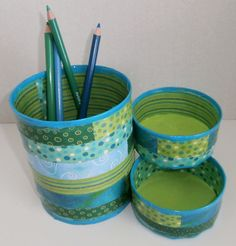Decorate tin cans with scrapbook paper or wallpaper.