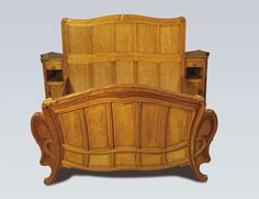 Bed -designed in 1894 -solid mahogany stained honey honey-brown oak colour -attached night stands. by Victor Horta