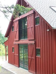 Classic barn house in 'barn red' color.The traditional sliding barn doors to cover the modern entry doors and windows look great!