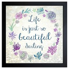Inspire yourself to reach for the stars each day with the Life Is Beautiful Darling Framed Wall Art. The watercolor print features a grey background with a circle of flowers and the quote Life is just so beautiful darling in teal, purple and grey.