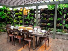a wall covered with scented herbs and fruit for a fresh way to eat while also adding structure to the space.