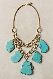 I kind of want this statement necklace but in the white and brown stones. I would love to own all three...the  Turquoise, the White, the Green...that would be a  bit much huh? haha