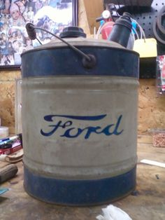 """I painted this for a friend. He had an old gas can that was already blue and white and being a """"Ford"""" guy he asked me to paint the emblem on both sides of the can for him with the old Ford logo. I used an acrylic blue paint and painted it to look worn like the original gas can."""
