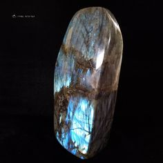 """Say hello to your new large Labradorite decor display crystal that shines gorgeous blue flash! This beautiful polished specimen stands flat on any table top and will light up your space with colorful vibes. Size: 12"""" H x 6"""" W x 3.5"""" D 305mm x 152mm x 90mm 18.4lbs / 8.3kg Tap the photo to buy it now. #crystals #homedecor #tablecenterpiece #deskdecor #fireplacedor #labradorite #crystaldecor Displaying Crystals, Sacred Geometry Art, Crystal Decor, Table Centerpieces, Labradorite, Light Up, 5 D, Size 12, Colorful"""