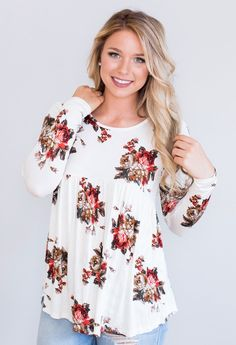 """Bring floral into the fall with this darling top! 95% Rayon, 5% Spandex Made in the U.S.A<3 Model is 5'4"""" size 4 in a small.    Measurements Length Bust   Small 27"""" 36""""   Medium 27.5"""" 38""""   Large 28"""" 40"""""""