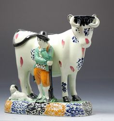 Antique Yorkshire pottery figure of a cow with farm hand in Pratt colours, c. 1810 Yorkshire England