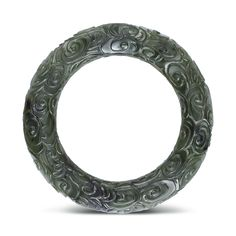 A SPINACH-GREEN JADE DISC, HUAN QING DYNASTY