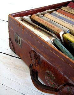 Vintage leather suitcase filled with vintage books.  Doesn't get any better than this!