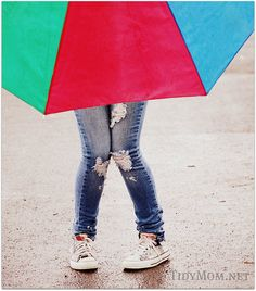 Love this umbrella / in the rain shot. The ripped jeans make this picture what it is, for sure!