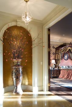 Tall art niche marking entrance to period styled bedroom of a luxury Traditional English Manor in Dallas, Texas
