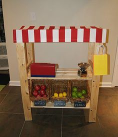 I have this shelf downstairs! I am so making a toy store for my kiddos.