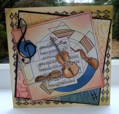 Violin and sheet music stamp. coloured with distress inks.