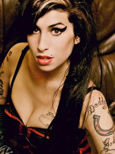 Amy Winehouse- beehive, tattoos, cat eyeliner, piercings, cute dresses and ATTITUDE <3