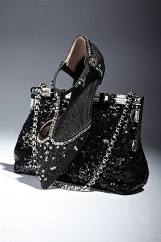 Put some sparkle in your step with Dolce & Gabbana's Jeweled T-Strap Brocade Flats and the Framed Sequined Clutch.