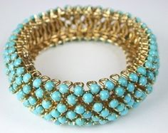 Wowsers. @Crystal Young you would rock this so well! When I see turquoise and gold I always think of you!