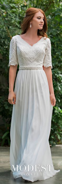 Modest Wedding Dresses TR11836 - Chiffon, mesh, and beaded lace A-line gown with scalloped elbow-length sleeves, wide scalloped V-neckline mirrored on back with a center zipper, attached belt at the natural waistline features a beaded design, flowing chiffon skirt with a sweep train.