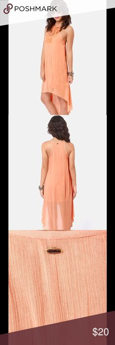 """O'Neil French Kiss Peach Hi Low Dress Good Preowned Condition no stains no holes. This gorgeous dress is very lightweight comes with a slip.  Preowned but in excellent condition. Size 3 Beachy woven peach fabric starts at high neckline with romantic floral crochet detail, then flutters down this flowing dress to a high-low hem for a carefree and kissable look. Small metal logo tag at back. Lined to mid-thigh. Model is wearing a size 0. Dress measures 14"""" longer at back. Shell: 100% Viscose…"""
