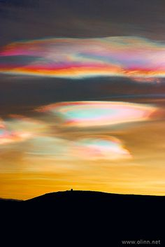 rainbow Nacreous Clouds - Iceland - Polar stratospheric clouds or PSCs, also known as nacreous clouds (from nacre, or mother of pearl, due to its iridescence), are clouds in the winter polar stratosphere at altitudes of 15,000–25,000 meters. They are best observed during civil twilight when the sun is between 1 and 6 degrees below the horizon. They are implicated in the formation of ozone holes.