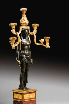 c1803 A pair of mercury gilt-bronze, patinated bronze and 'rouge griotte' marble Egyptian candelabra, French Consulat, circa 1803, made under the direction of Martin-Éloi Lignereux Estimate 70,000 — 100,000 EUR LOT SOLD. 118,750 EUR